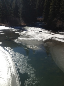 Crossing over the beautiful river with its ice and flow.